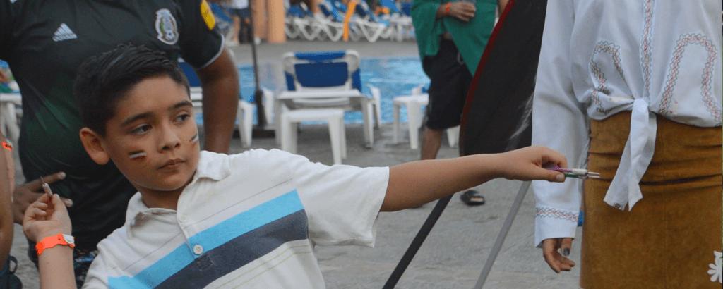 Playing Darts at Royal Solaris Los Cabos