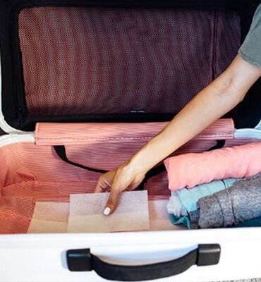 Putting dryer sheets on your luggage