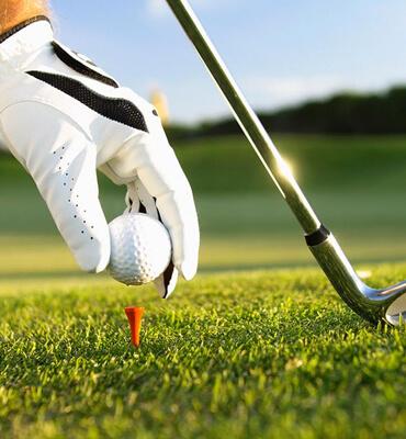 Jugando Golf en los Campos de Cancun